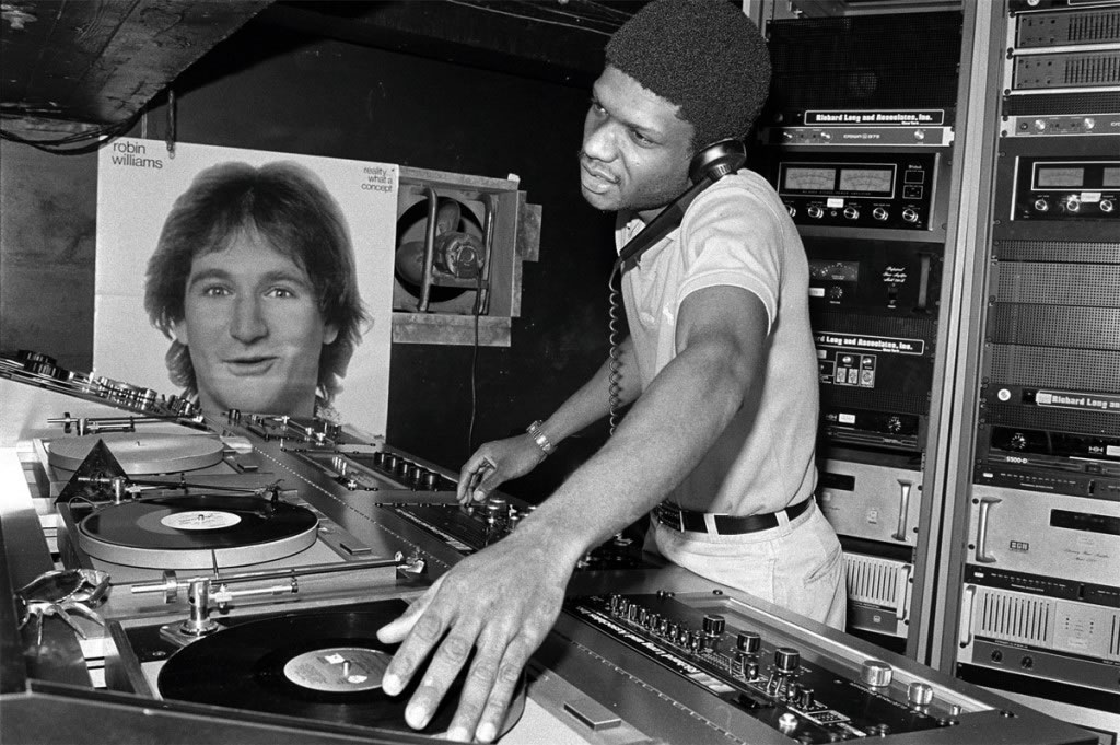 DJ Larry Levan at the Paradise Garage, New York, 1979. © Bill Bernstein